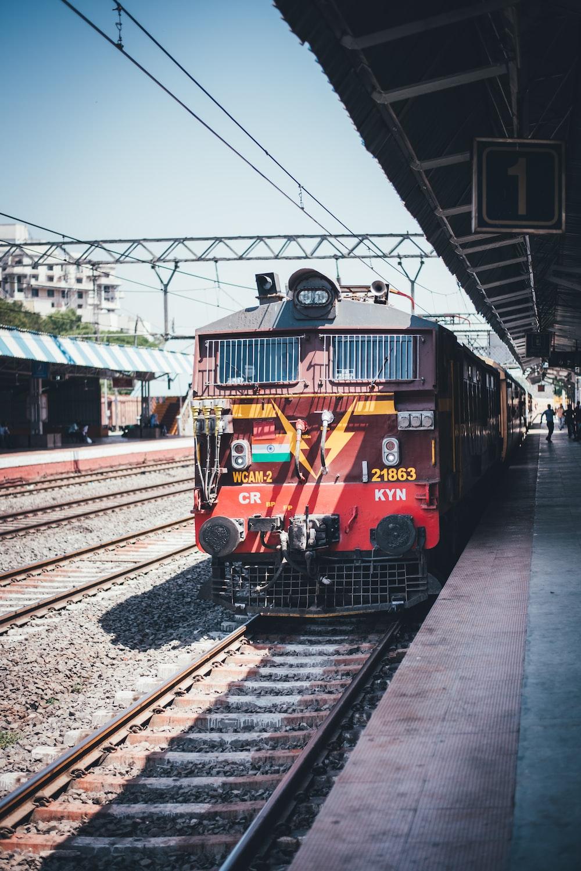 red train on a station platform