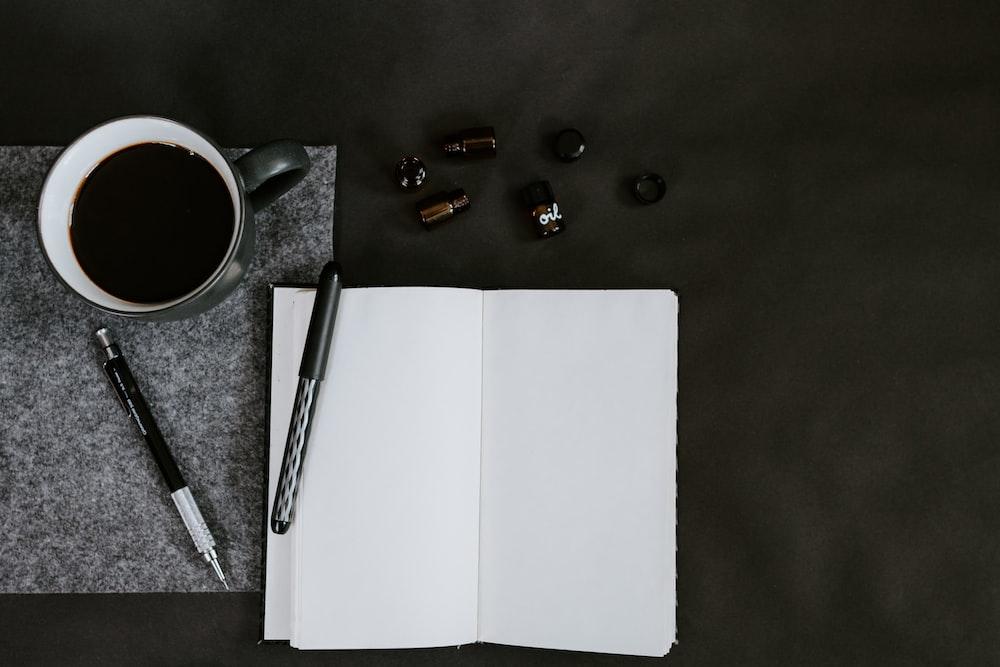 flat lay photo of coffee mug and pencils