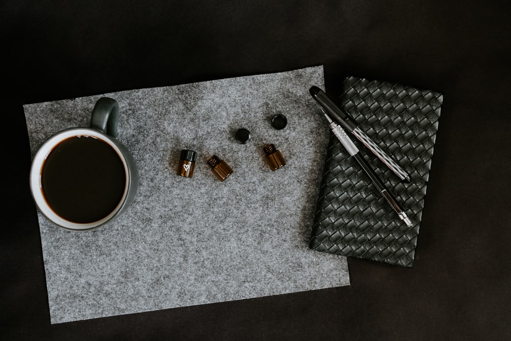 green cup on gray mat