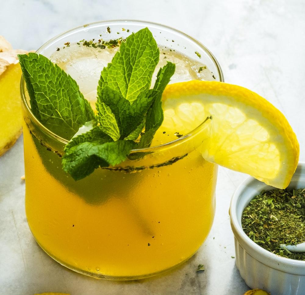glass of lemon drink with slice of lemon