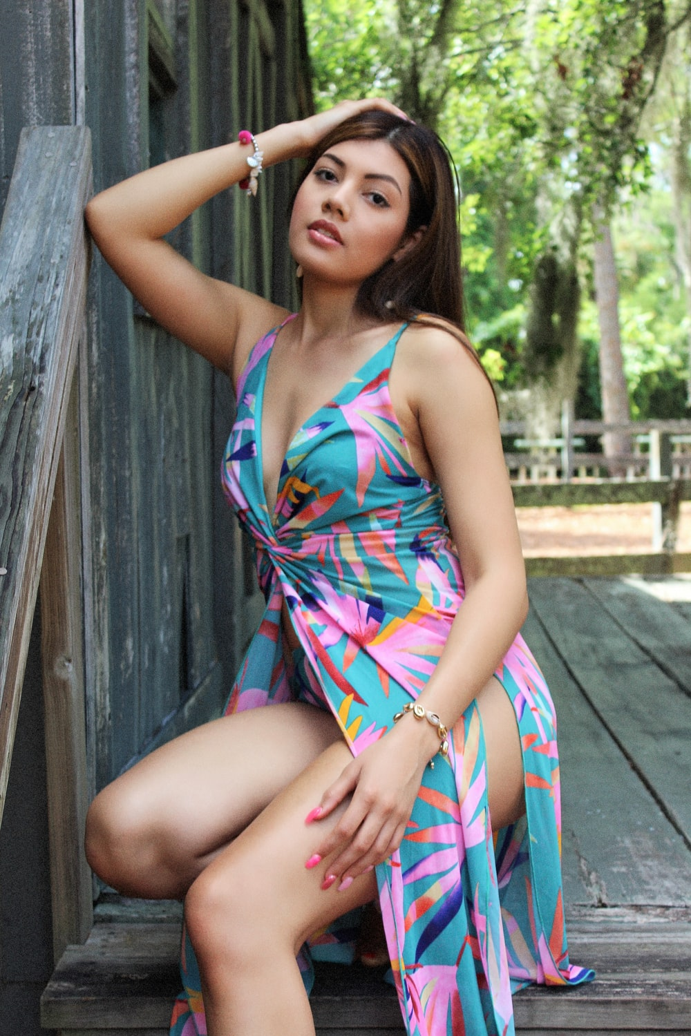 woman sitting on wooden ground