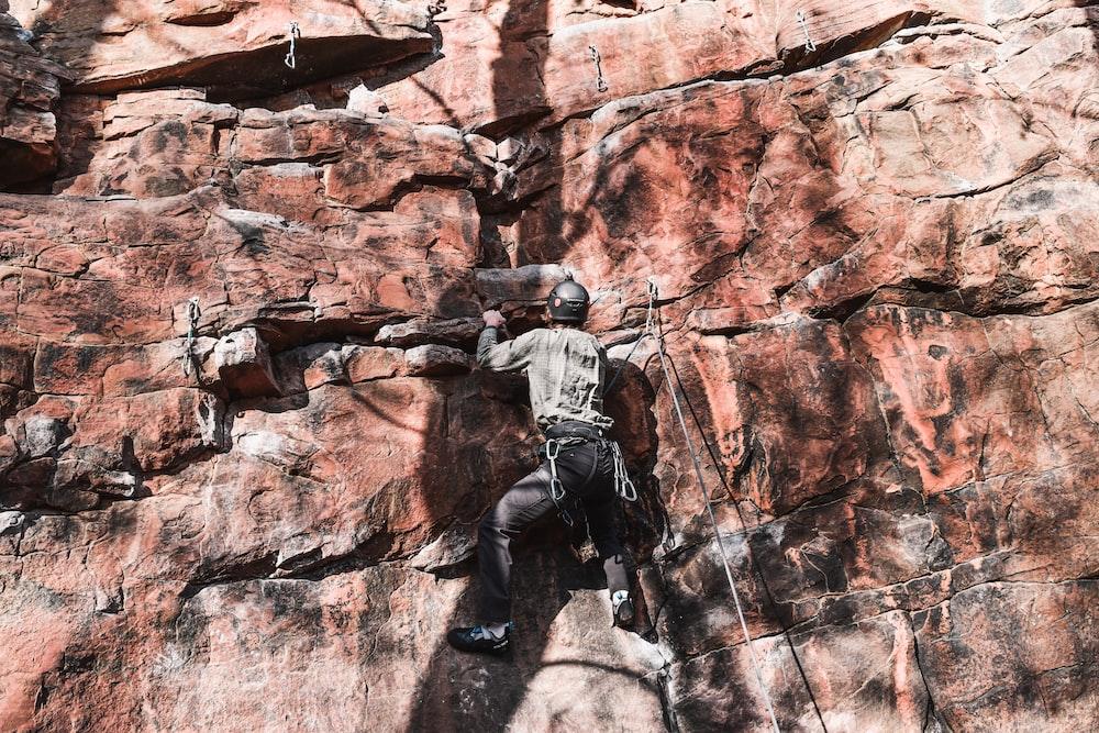 man doing rock climbing