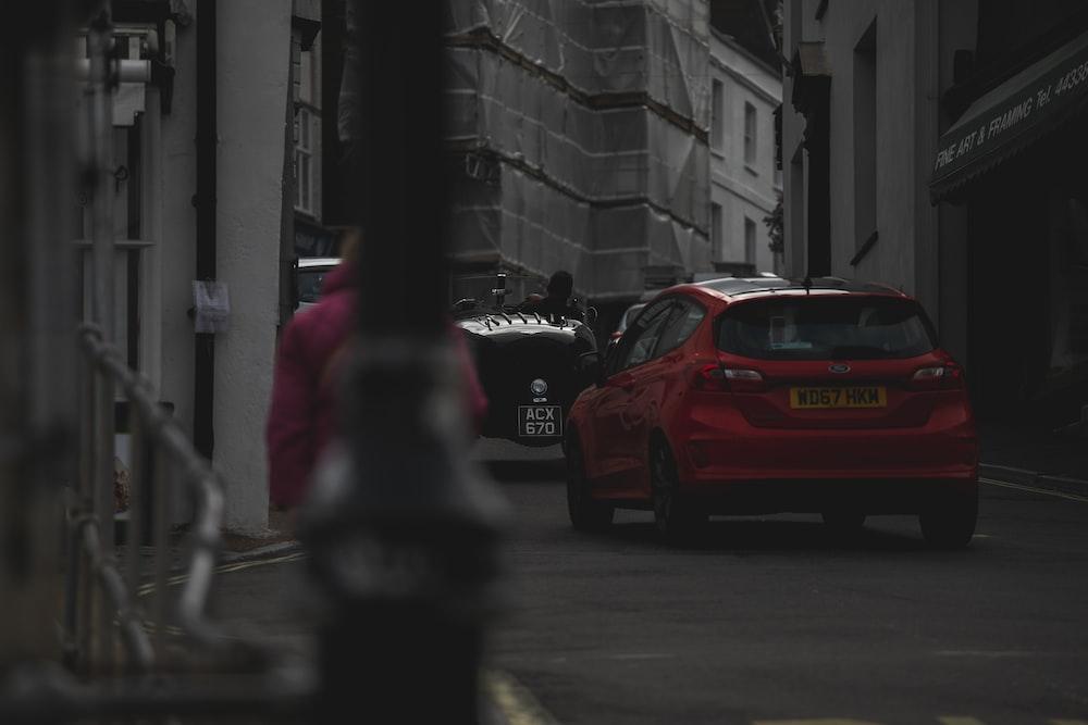 red hatchback near building
