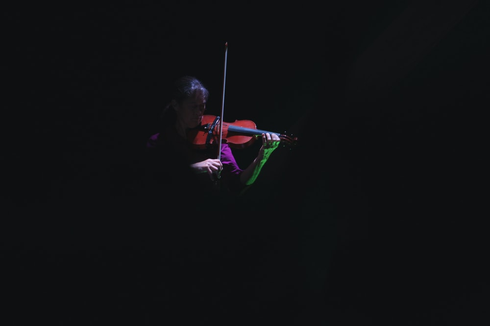 person playing violin