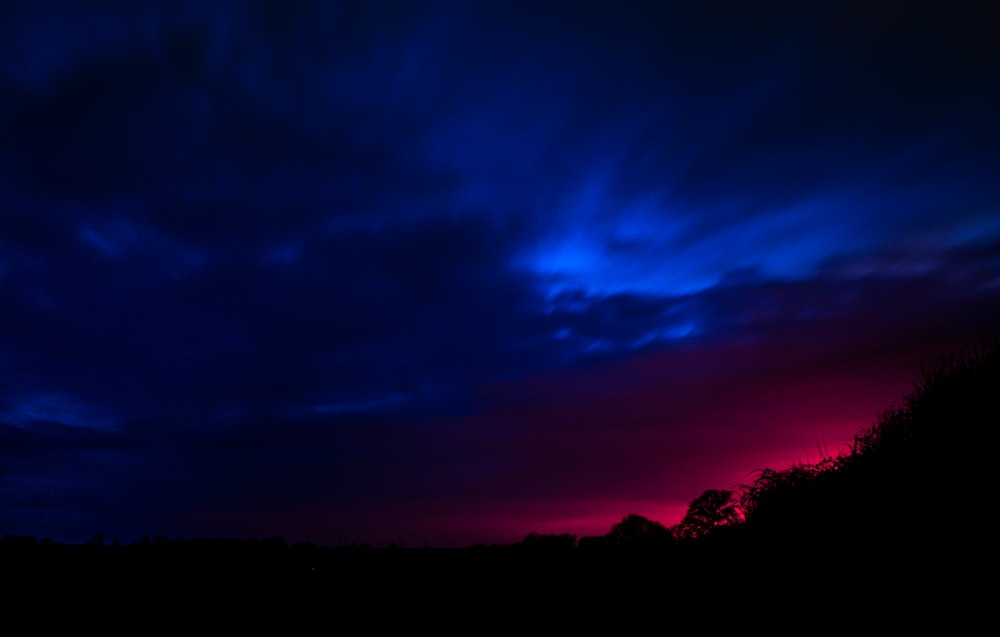 purple and blue sky during sunset