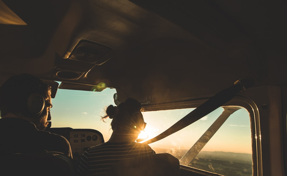 silhouette of person inside plane