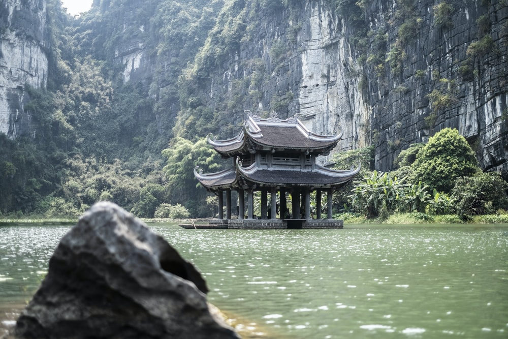 ancient building near body of water during daytime