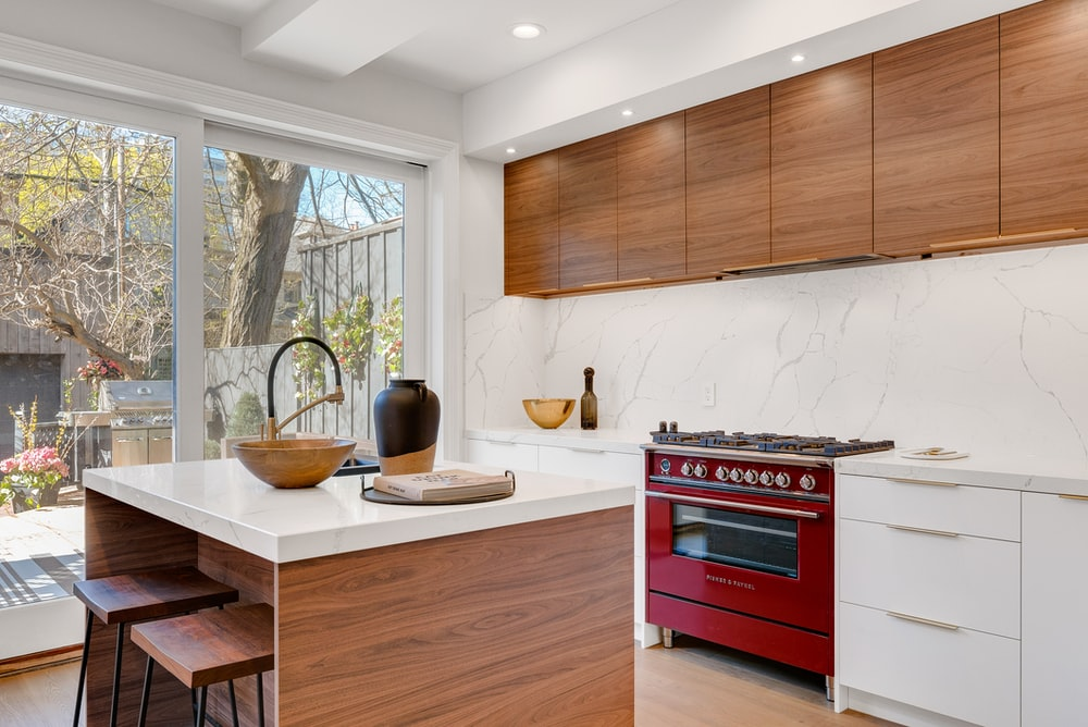 kitchen island near gas range beside base cabinets