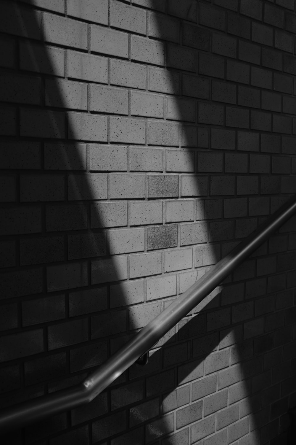 grayscale photo of stair rail