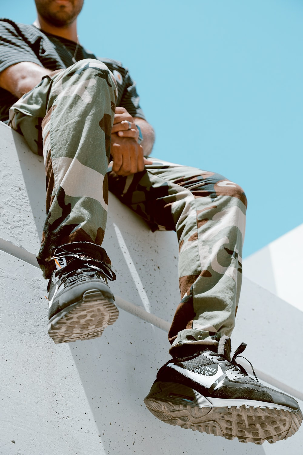 shallow focus photo of man in woodland camouflage pants