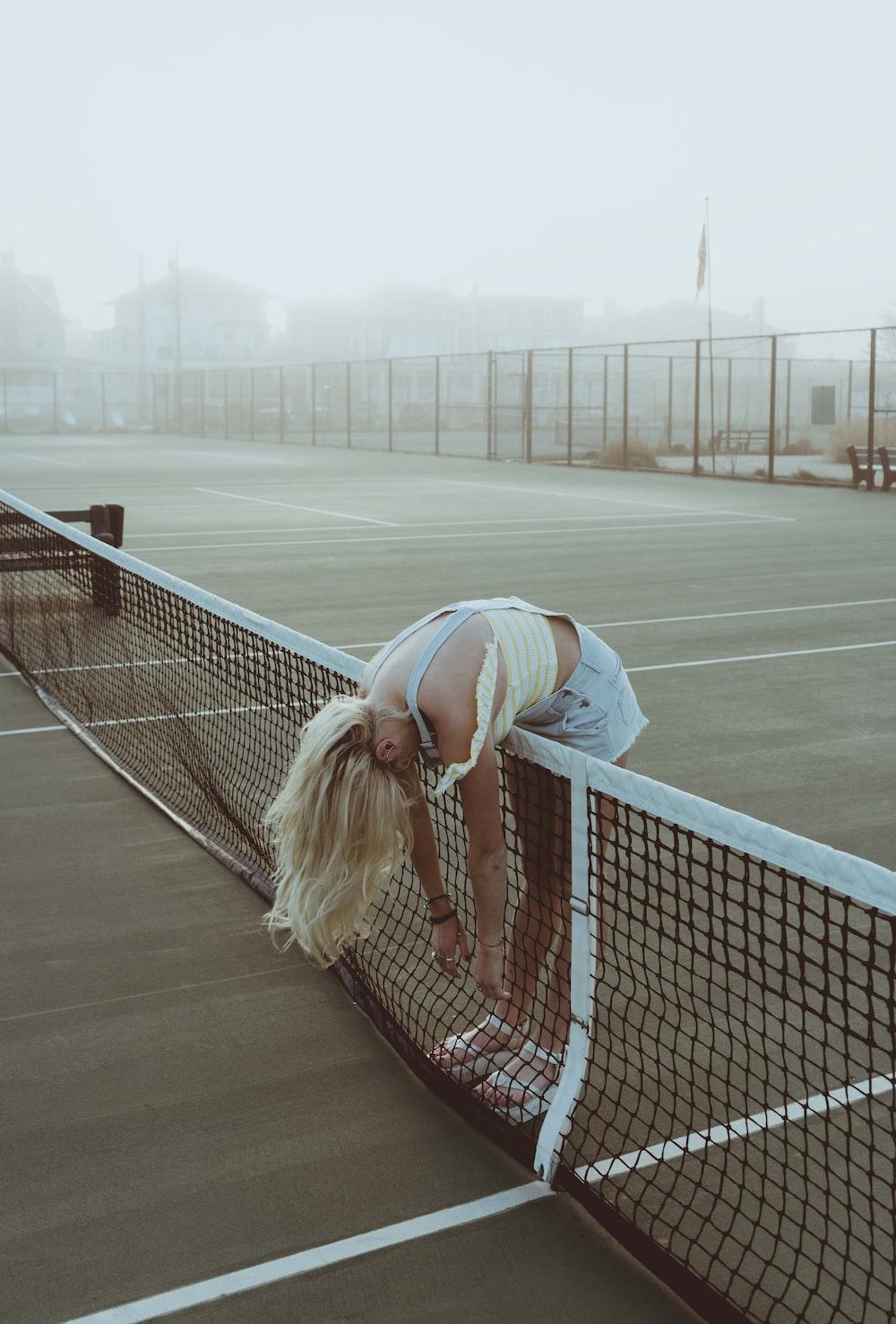 unknown person standing near tennis net