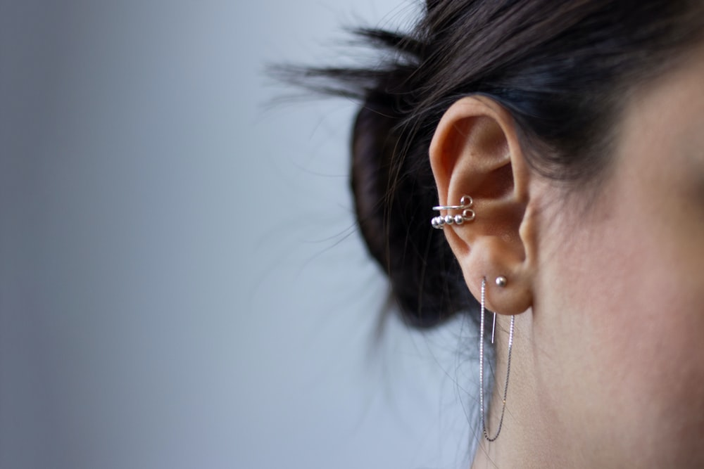 silver-colored earrings