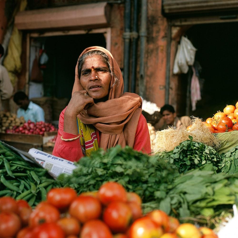 shallow focus photo of woman wearing brown hijab headdress