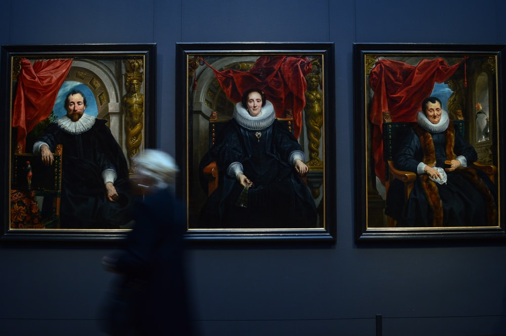 three persons sitting on chair paintings