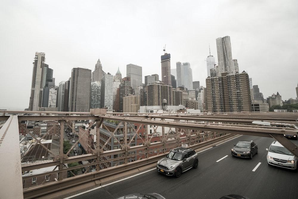 vehicle crossing bridge during daytime