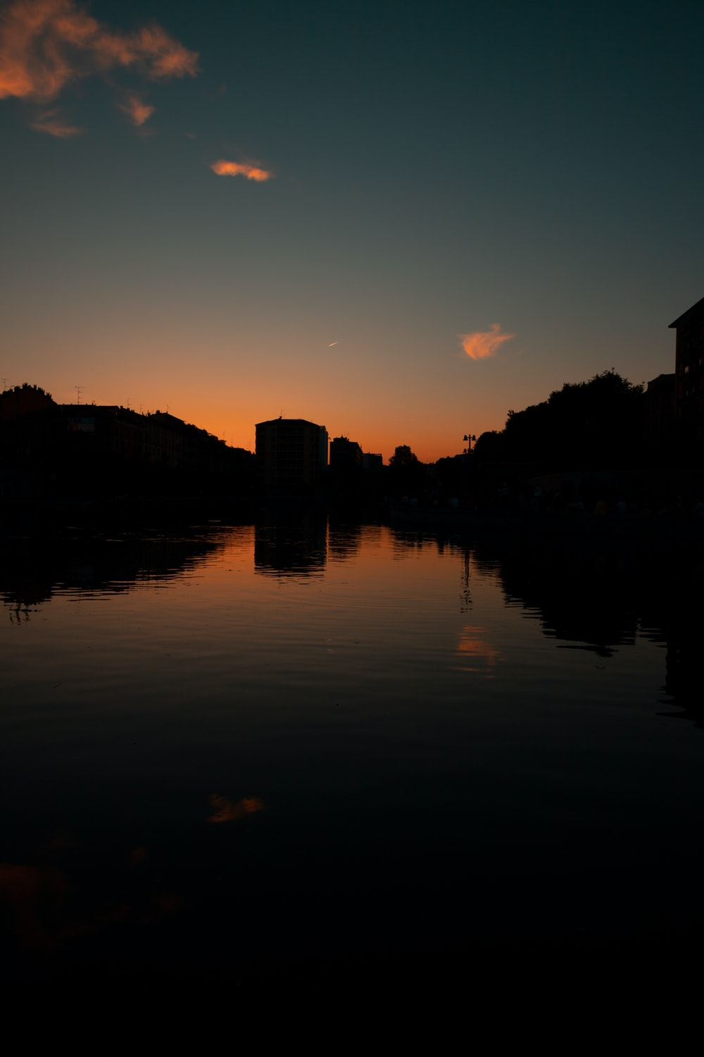 silhouette photography of body of water during golden hour