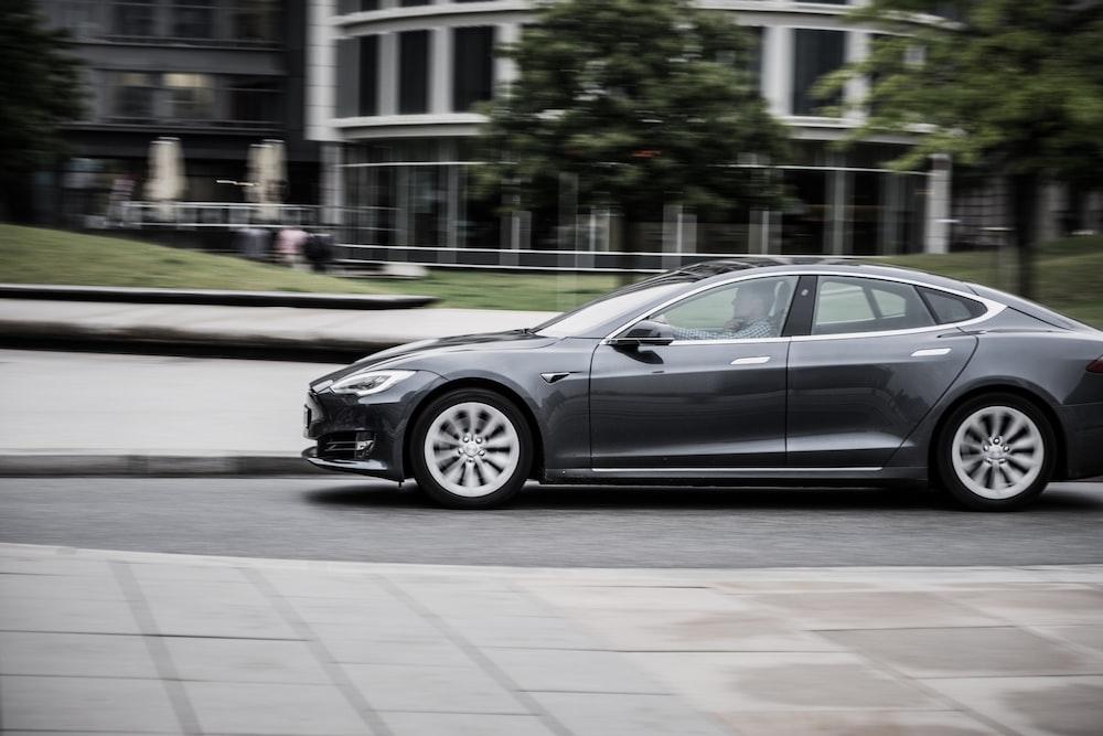 panning photography of sedan