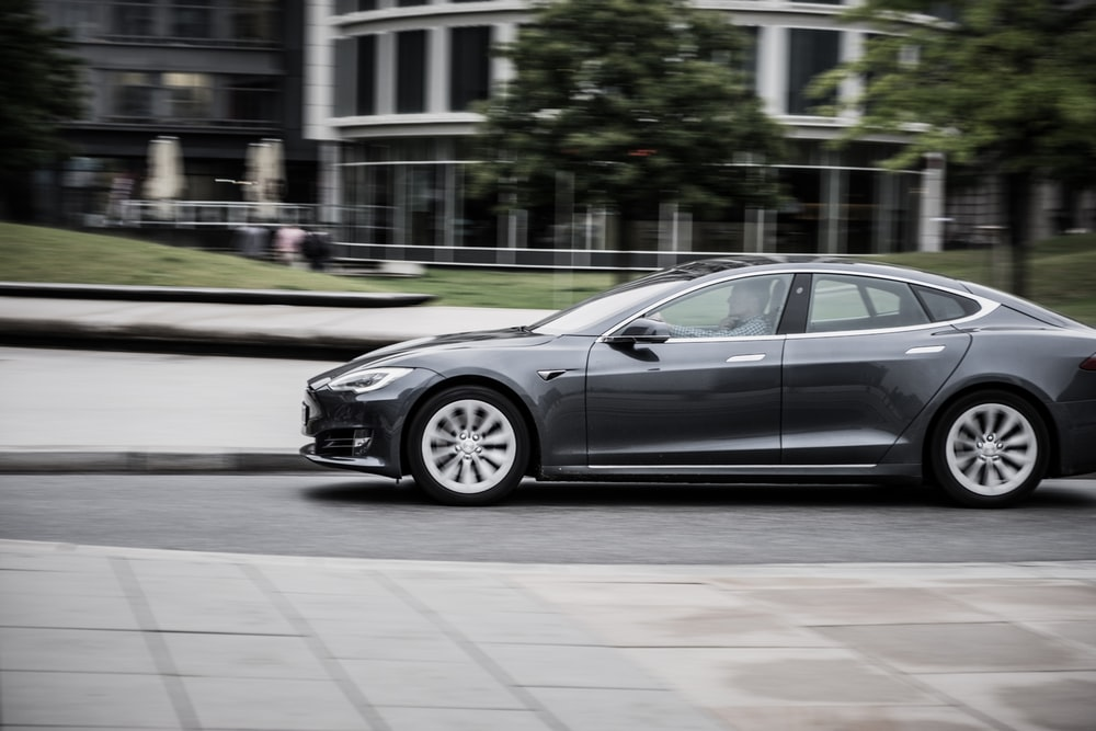 panning photography of sedan