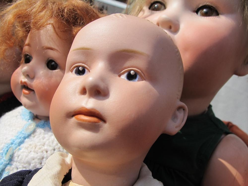 three baby dolls
