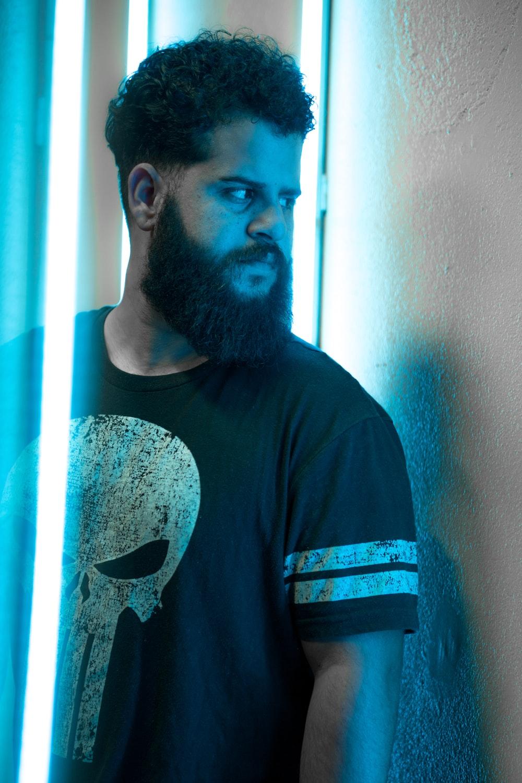 man wearing black Punisher crew-neck shirt