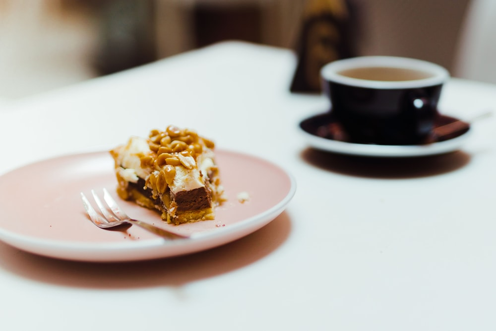 cake on plate near cup