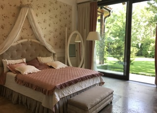white and pink comforter bed