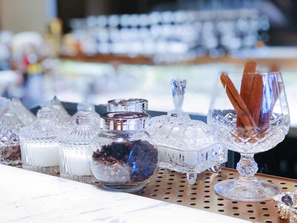 assorted-color clear glass condiments jar