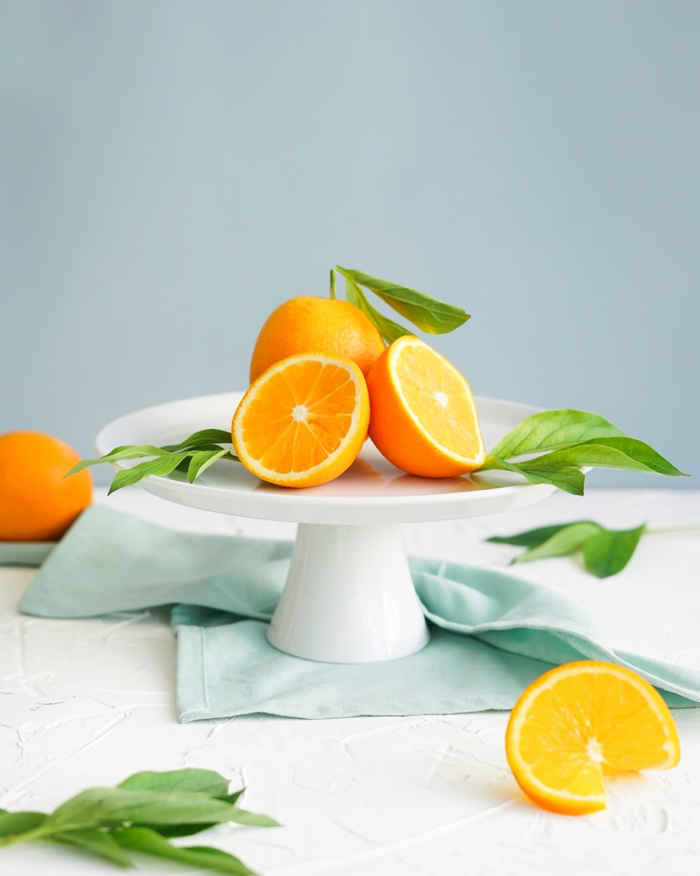 orange fruit in white ceramic plate close-up photography