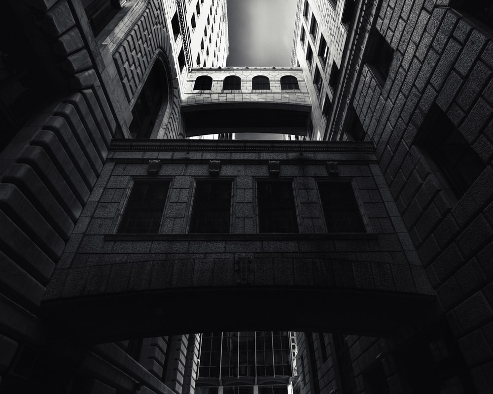 grey-scale photography of a building close-up photography