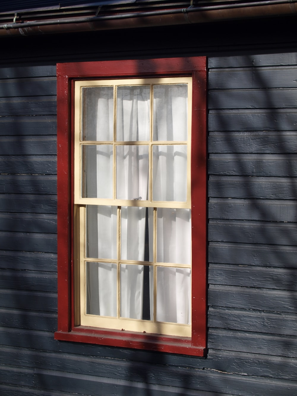 white and red French window frame