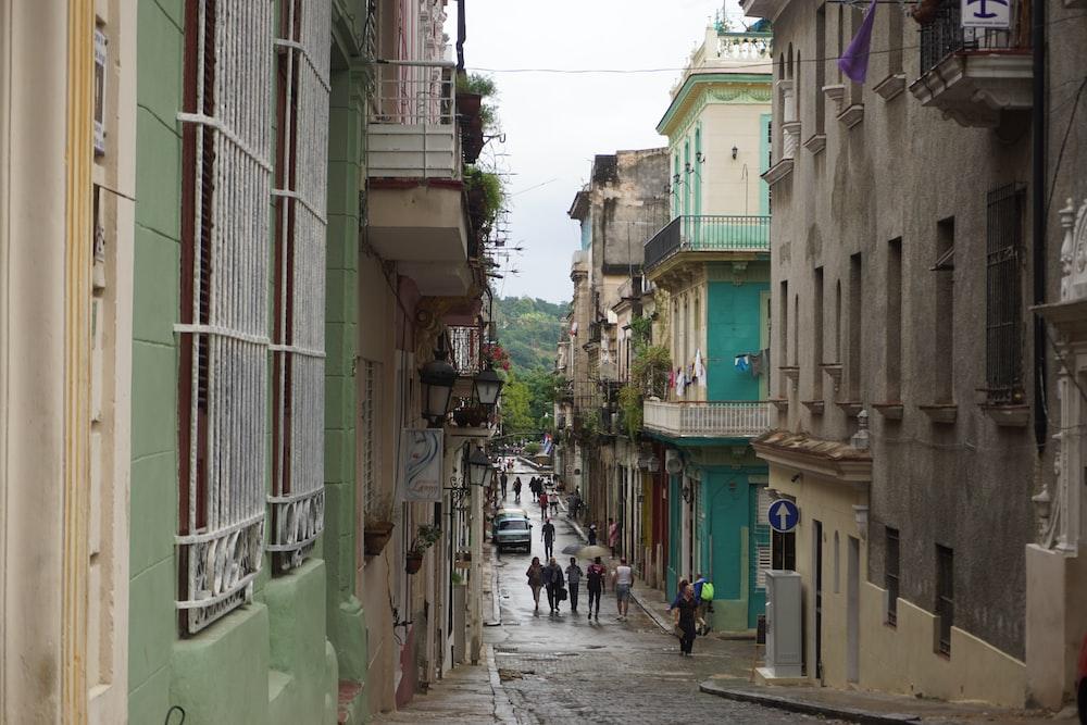 people walking near street between buildings during daytime