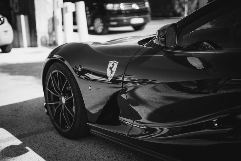 grayscale photography of Ferrari coupe