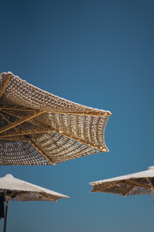 several brown parasols