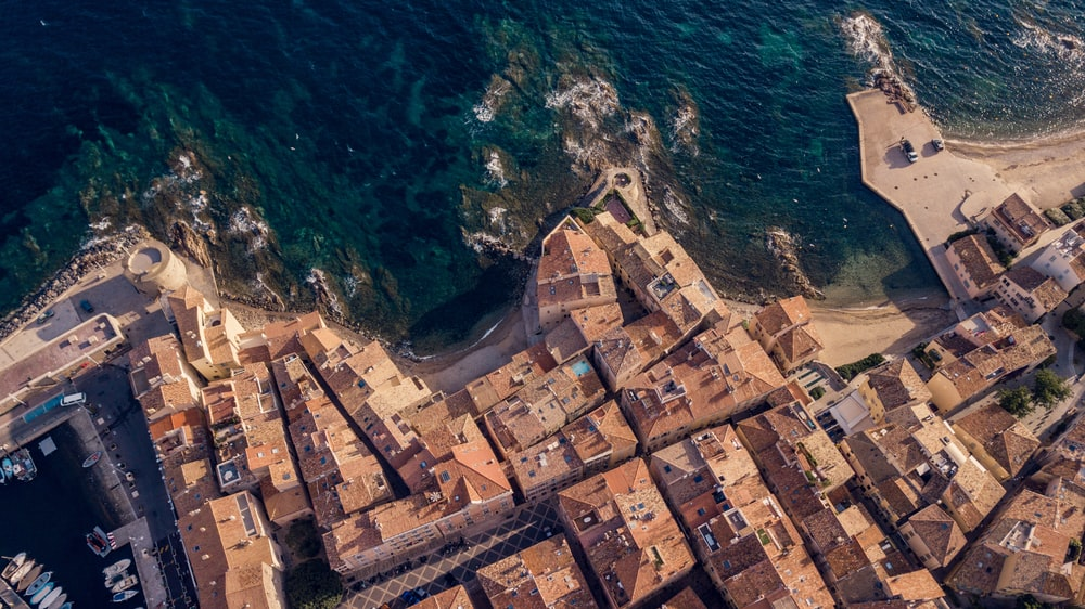 aerial view of houses near body of water