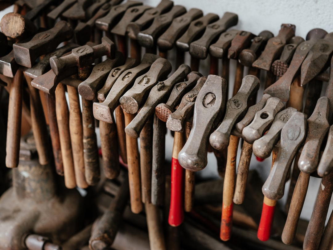 A collection of vintage hammer in the metal workshop MA Nouvelle Orfèvrerie in Bordeaux, France.