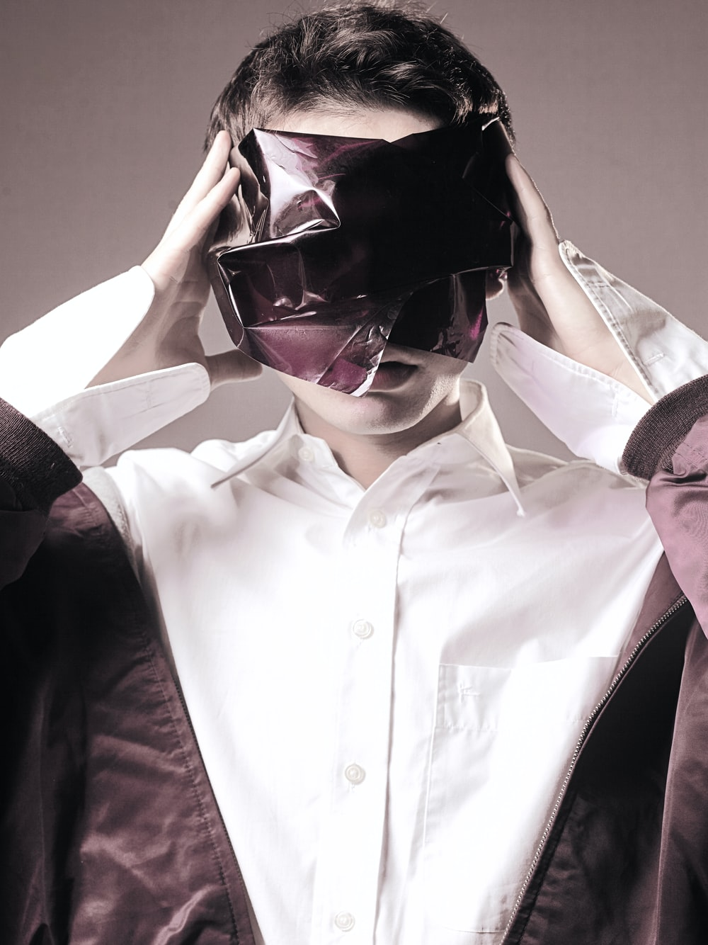 person covering its eyes close-up photography
