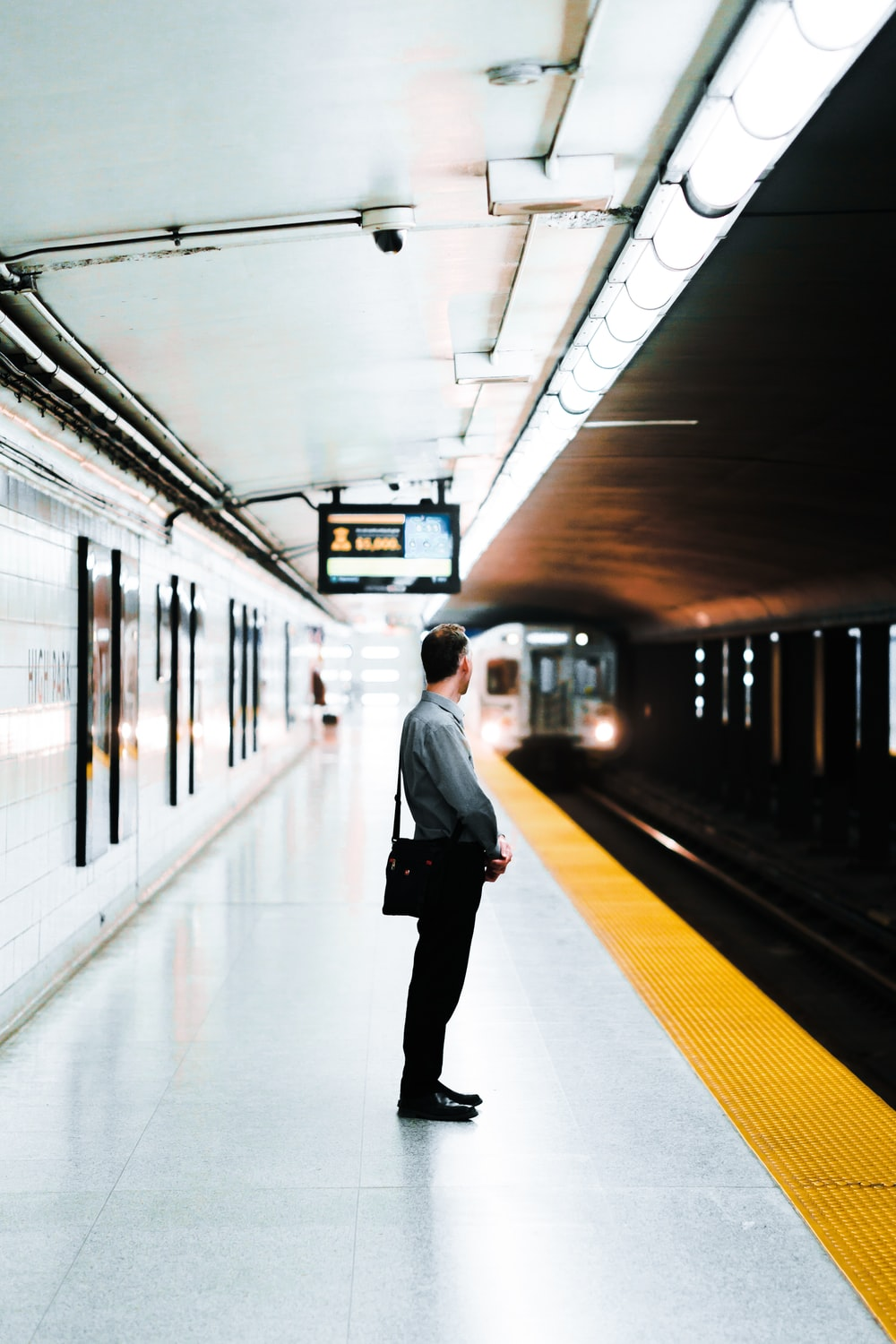 man standing at the train station