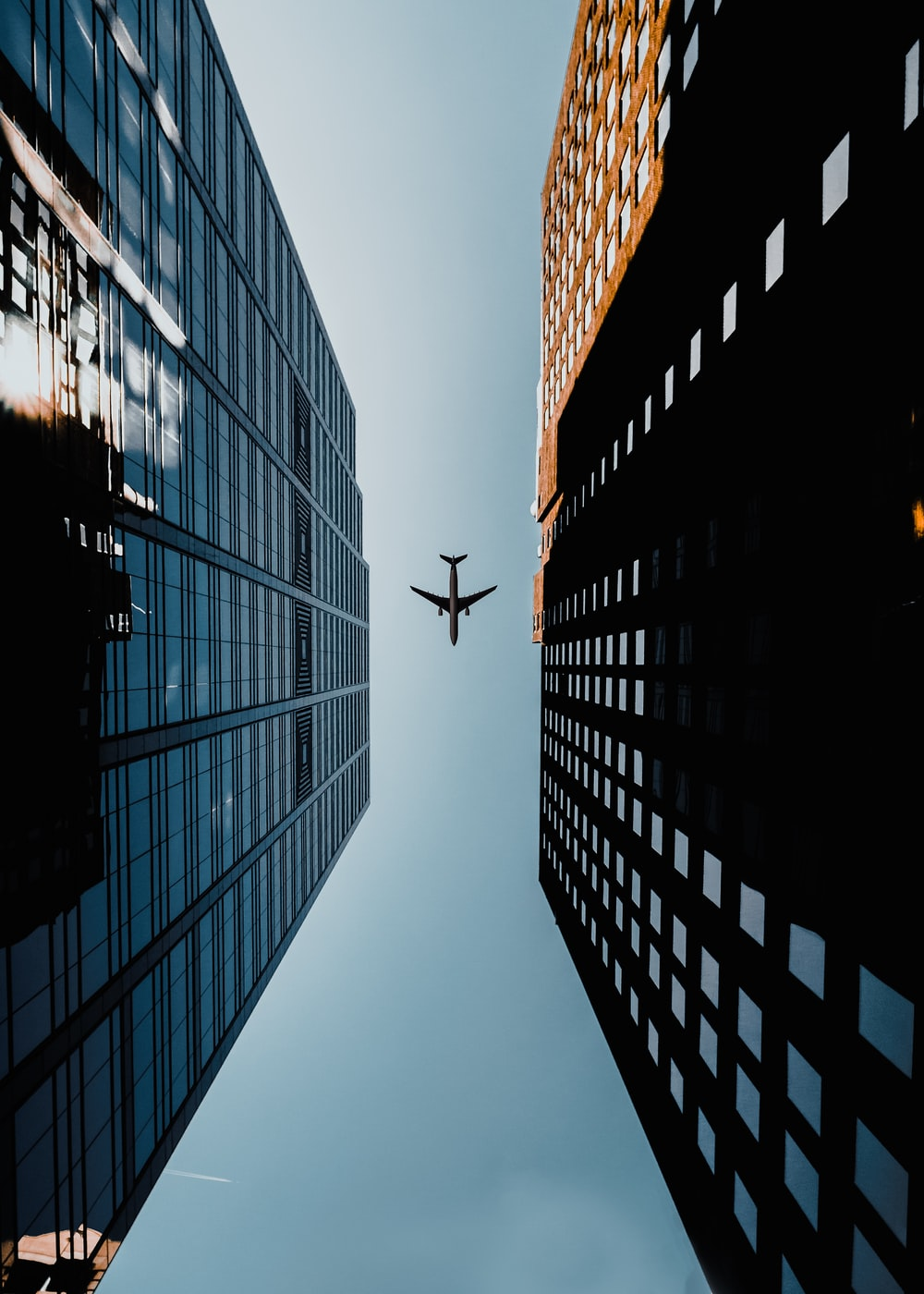 low angle photography of airliner