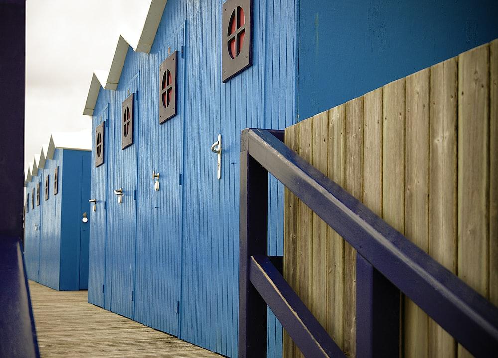 blue wooden sheds