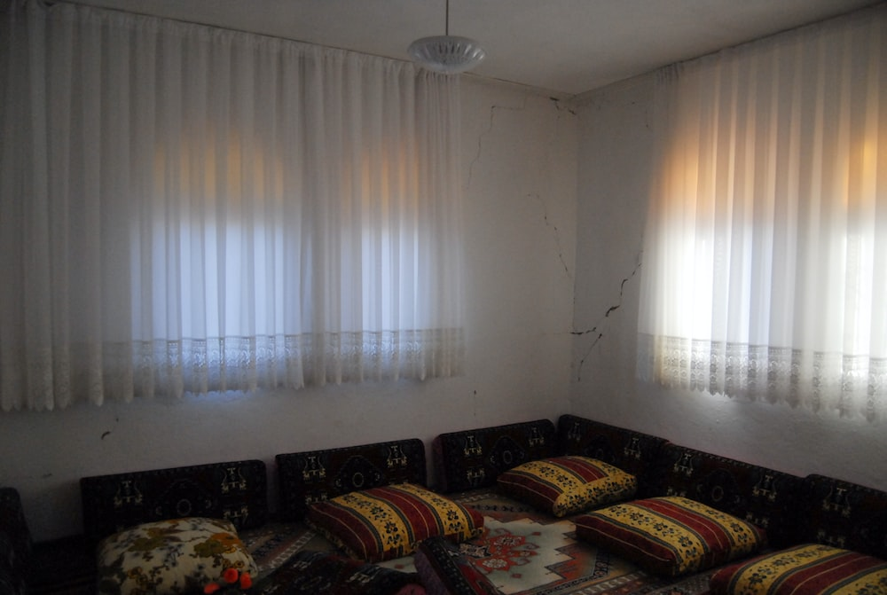 closed white window curtain
