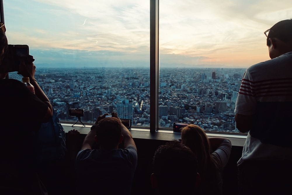 people looking down through high-rise buildings