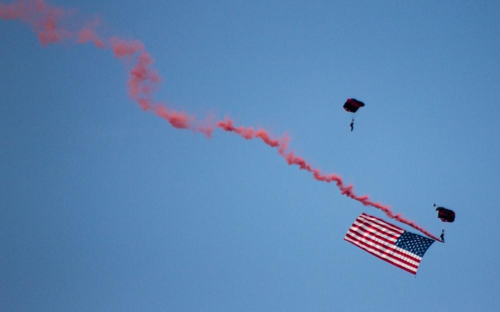US flag on mid air under clear blue sky