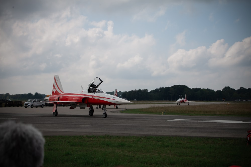 red and white jet plane