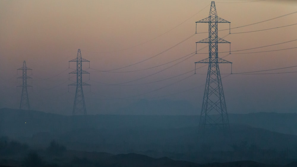 electrical towers during golden hour