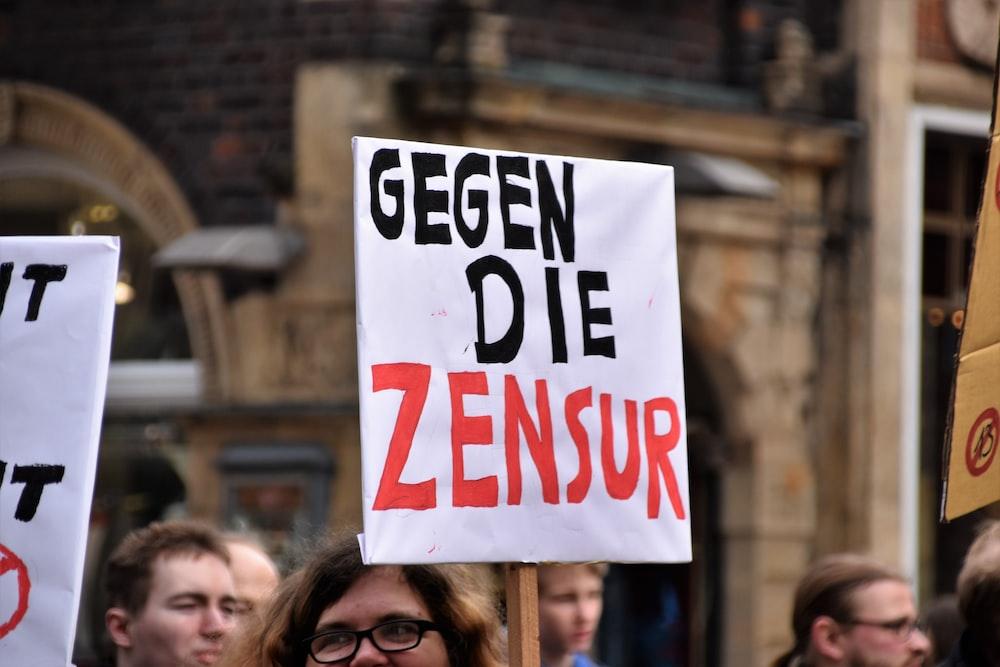 person holding gegen die zensur signage