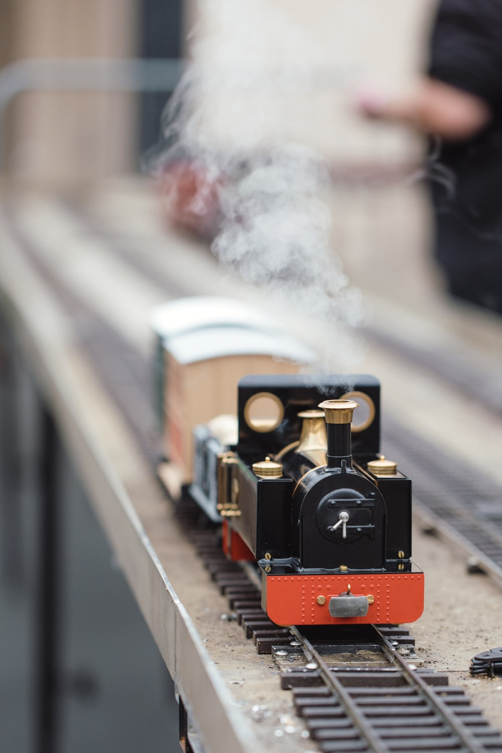 selective focus photography of red and black train die-cast