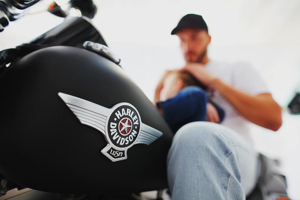 man riding Harley-Davidson motorcycle