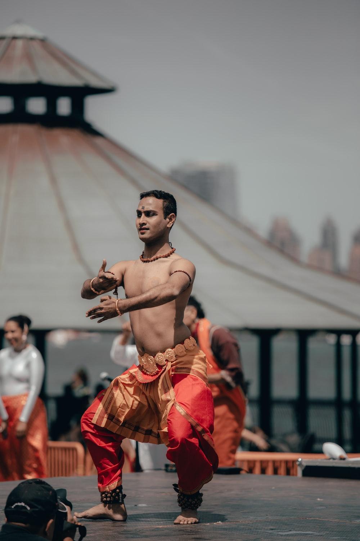 man wearing red and orange pants