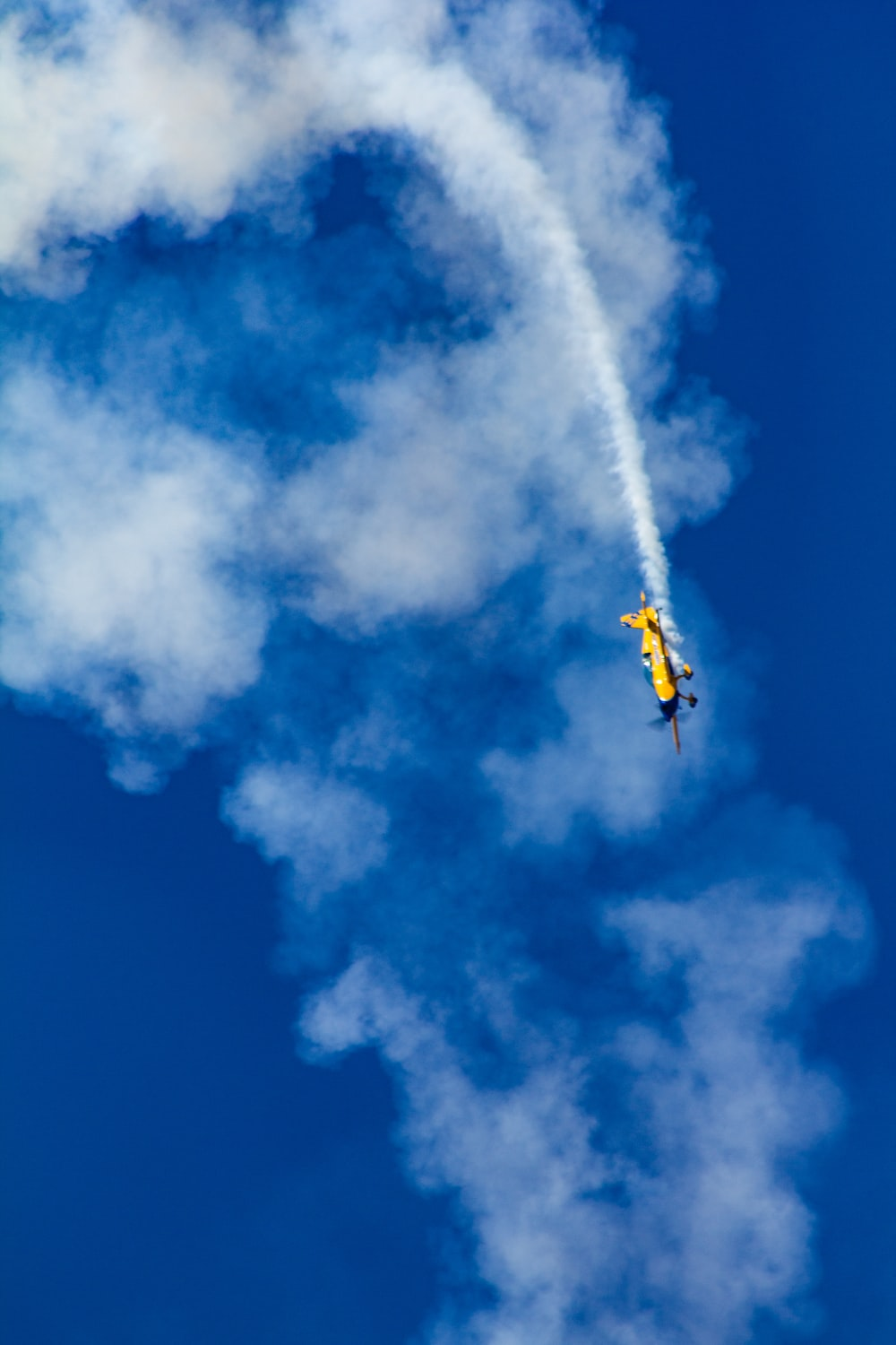 yellow plane in aerial show