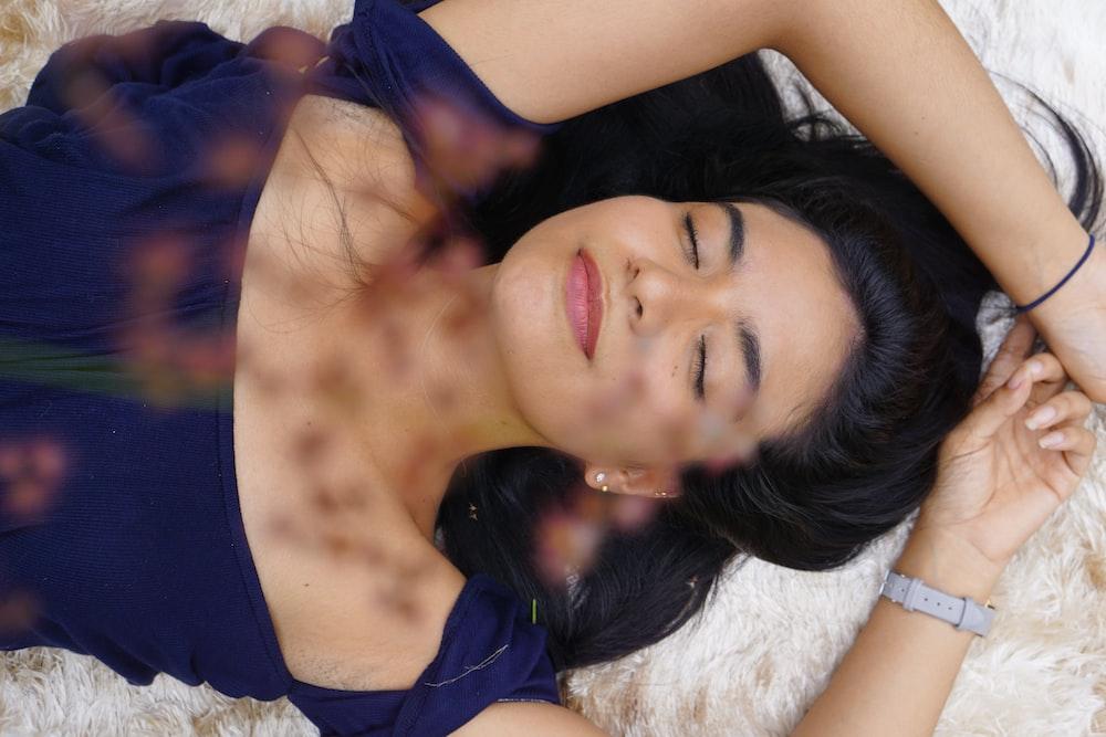 woman lying on beige fur textile